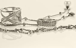 Silver ring with precious stones and fine silver chain Stock Image