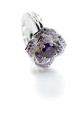 Silver ring with a purple stone. Royalty Free Stock Photography
