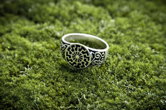 Silver ring solstice. Ring solstice on moss.That silver ring was crafted by Russian  jeweler on Ancient Russia festival in Moscow Royalty Free Stock Photo