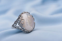 Silver ring with white stone Stock Photo
