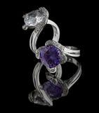 Silver rings with diamonds on black stock photos