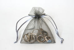 Silver rings in a mesh bag Stock Photos