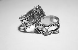 Silver rings. Old silver rings on a light background Royalty Free Stock Photography