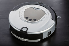 Silver robot vacuum cleaner Royalty Free Stock Photos