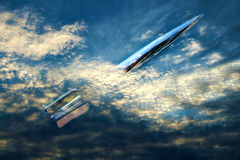 Silver Rocket Flies Through Clouds Stock Image