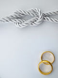Silver rope and double gold ring Stock Photo