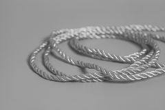 Silver rope on gray background Royalty Free Stock Images