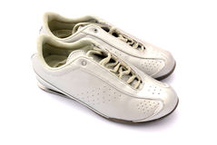 Pair of jogging trainers. Pair of silver jogging shoes or trainers, white background Royalty Free Stock Photos