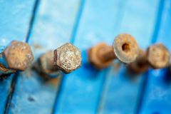 Silver rusty old Industrial screw nut and bolt. Selective focus Stock Image