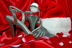 Silver sandals and santa hat Stock Photo