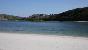 Silver Sands of Morar beautiful white sand beach in Scotland clear turquoise sea on the coastline from Arisaig to Morar pan stock video