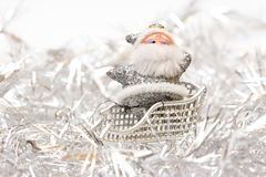 Silver santa in a sledge Stock Images