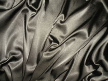 Silver satin. Rough silver satin suitable as background Royalty Free Stock Image