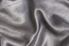 Silver satin, a background. Or texture Royalty Free Stock Photo