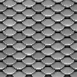Silver Scales. A texture that looks like shiny, silver armor or even the scales on a fish or reptile.  This image tiles seamlessly as a pattern Royalty Free Stock Images