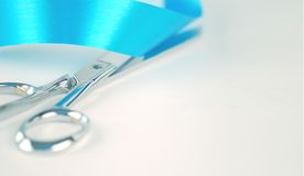 Silver Scissors Cutting Ribbon Royalty Free Stock Image