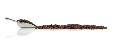 A silver scoop with coffee beans on white Royalty Free Stock Photo