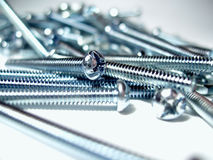 Silver screws. In a pile.  Center focus Royalty Free Stock Photos