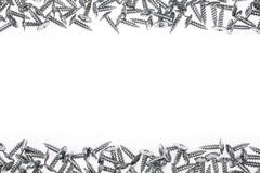 Silver screws on white background Royalty Free Stock Photos