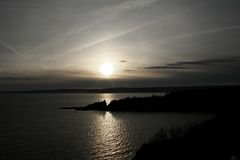 Silver Sea. Sunset at Cape Enrage, NB Royalty Free Stock Photography