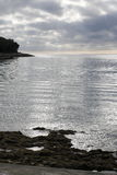 The silver sea. A suggestive inverval sunset over the silver sea Royalty Free Stock Photography