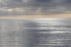 The silver sea. A suggestive inverval sunset over the silver sea Stock Photo