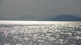 Silver sea. Sun send flashes on a sea Royalty Free Stock Photo