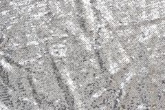 Silver sequins textile background royalty free stock images