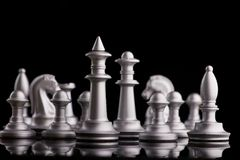 Silver set chess pieces on a black Royalty Free Stock Photos