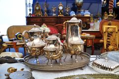 Silver set in flea market. Silver set in a flea market royalty free stock images