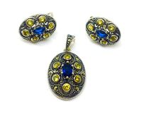 Silver set. 925 sterling silver with blue and yelow cristals stock photography