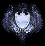 Silver shield. With angel wings, chimera on a dark background Stock Images