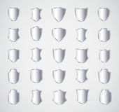 Silver shield design set with various shapes. EPS 10 Stock Photos