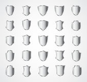 Silver shield design set with various shapes. EPS 10 Royalty Free Stock Photography