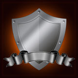 Silver shield and ribbon. Royalty Free Stock Image