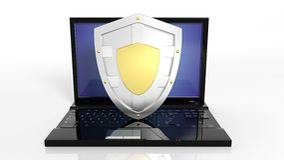 Silver shield symbol on laptop black keyboard Stock Images