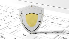 Silver shield symbol on laptop Stock Images