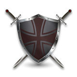 Silver shield with two swords. Stock Photo