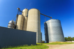 Silver, shiny agricultural silos Stock Image