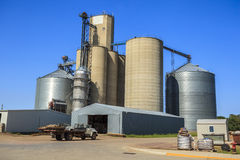 Silver, shiny agricultural silos Royalty Free Stock Photos