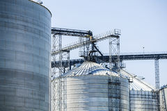Silver, shiny agricultural silos Royalty Free Stock Photo