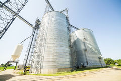 Silver, shiny agricultural silos Stock Images