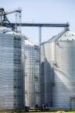 Silver, shiny agricultural silos Stock Photos