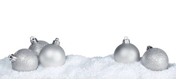 Silver shiny christmas balls in snow isolated on. Balls shiny christmas silver happy holidays holiday party leisure royalty free stock photos