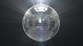 Silver shiny disco ball on black background stock footage