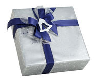 Silver shiny gift box paper wrap blue ribbon bow bell decoration isolated Royalty Free Stock Image