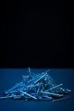 Silver shiny iron nails Stock Images