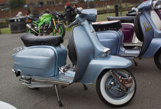 Silver shiny vintage grey motor scooter parked in Rye Stock Photo