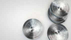 Silver siacoin coins falling on white background. Animation stock footage