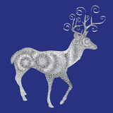 Silver silhouette of a deer on a blue background. Stock Photos